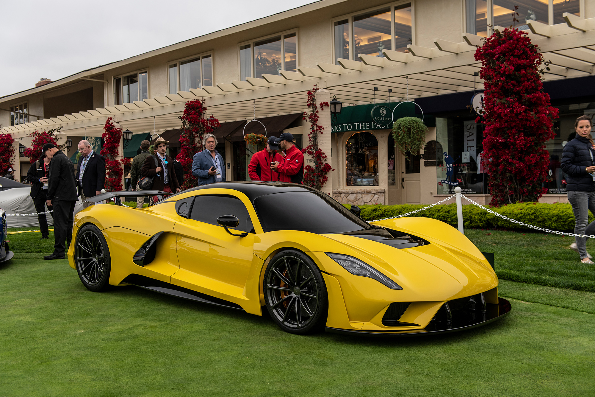 John Hope Hennessey On The Concept Car Green In Front Of Lodge At Pebble Beach